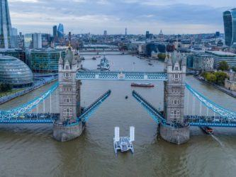 Energy Observer sailing under Tower Bridge