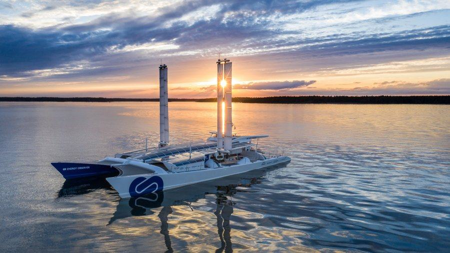 Energy Observer on a flat sea as the sun sets