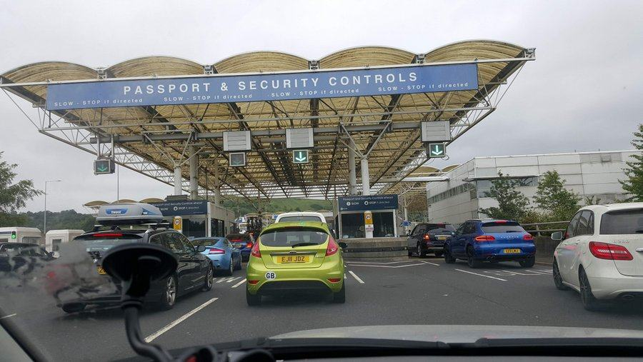 Cars queueing at Eurtunnel Folkestone for 'Passports & Security' kiosks