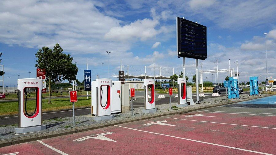 A row of E-charging stations looking like petrol pumps