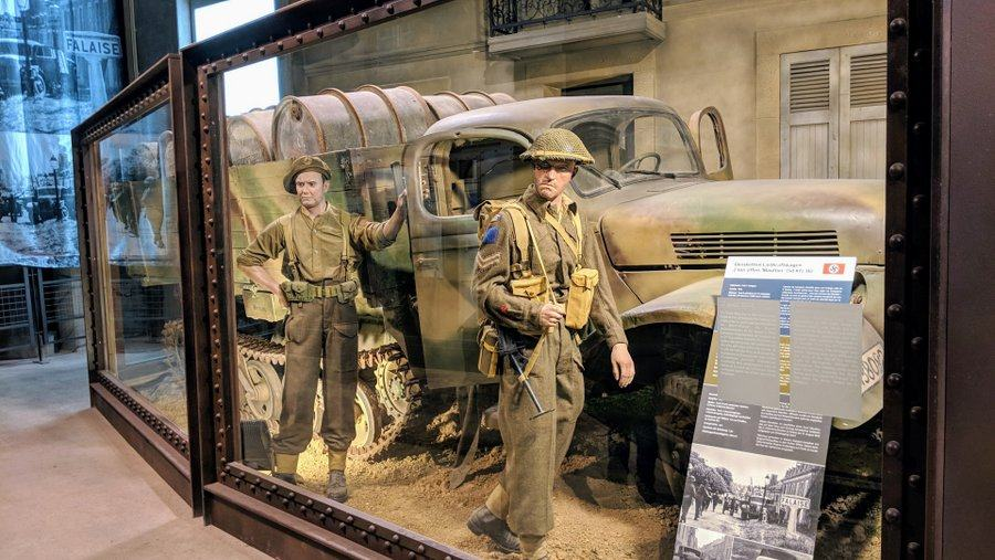 Diorama with two soldiers and a half track truck