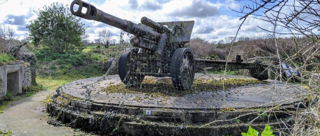 A field gun under camouflage netting