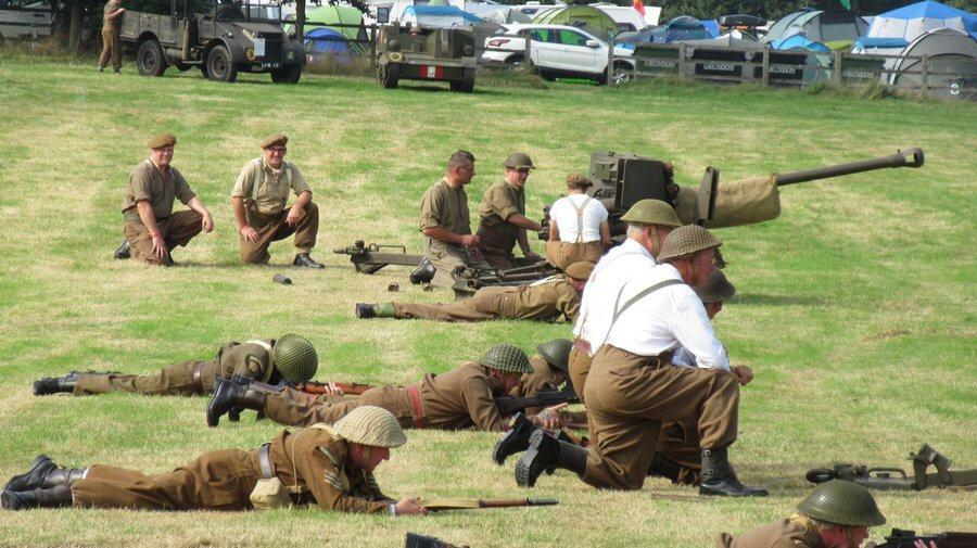 Gunners kneel by their field guns at We Have Ways Fest