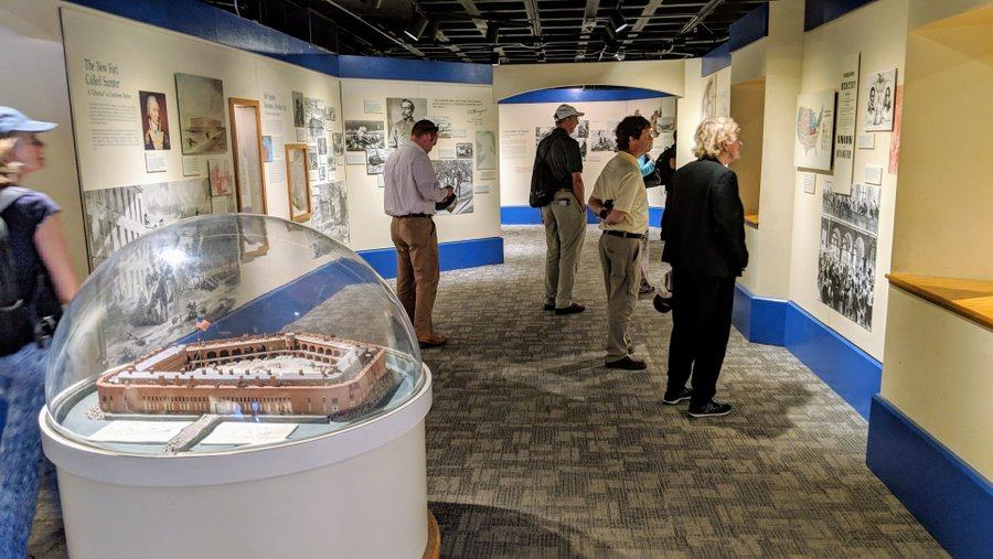 Visitors look at displays in the Fort Sumter museum