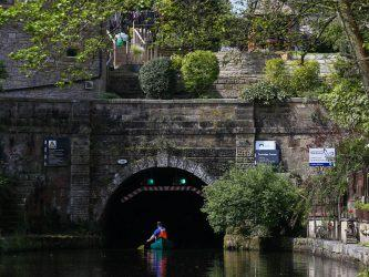 Canoeist enters the tunnel