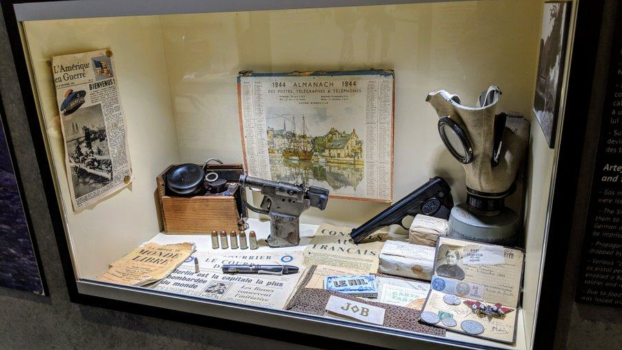 Display case with papers & weapons
