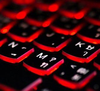 Close up of a red backlit gaming keyboard