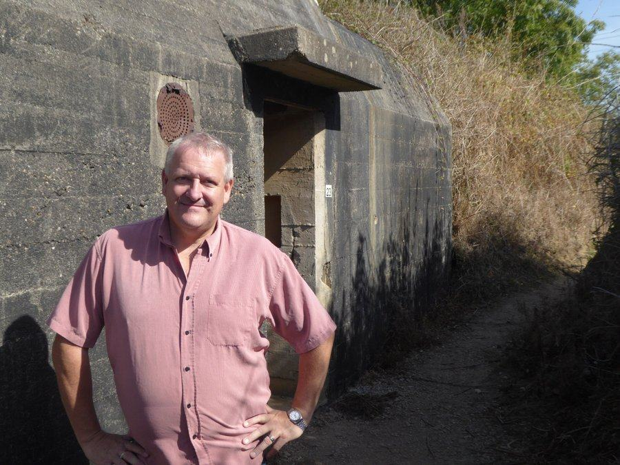 Gary Sterne standing outside the entrance to an excavated bunker