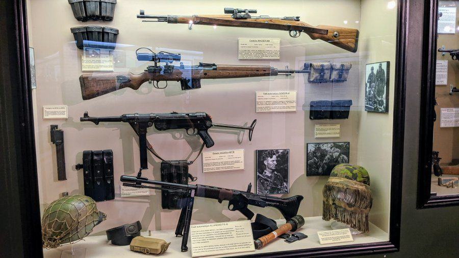 A display case with rifles in it