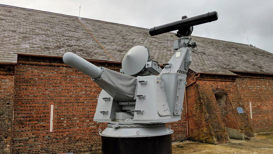 Grey gatling gun mounting with radar on top