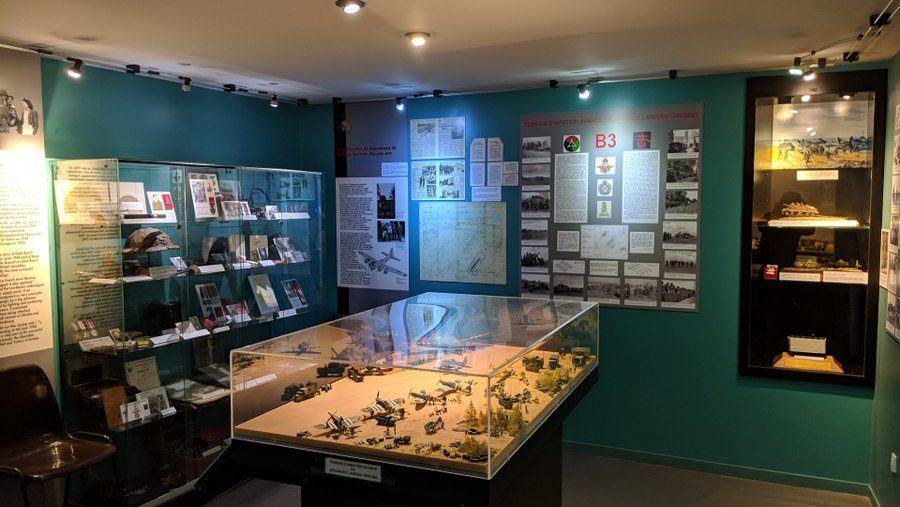 A gallery with a model display case in the centre of the room