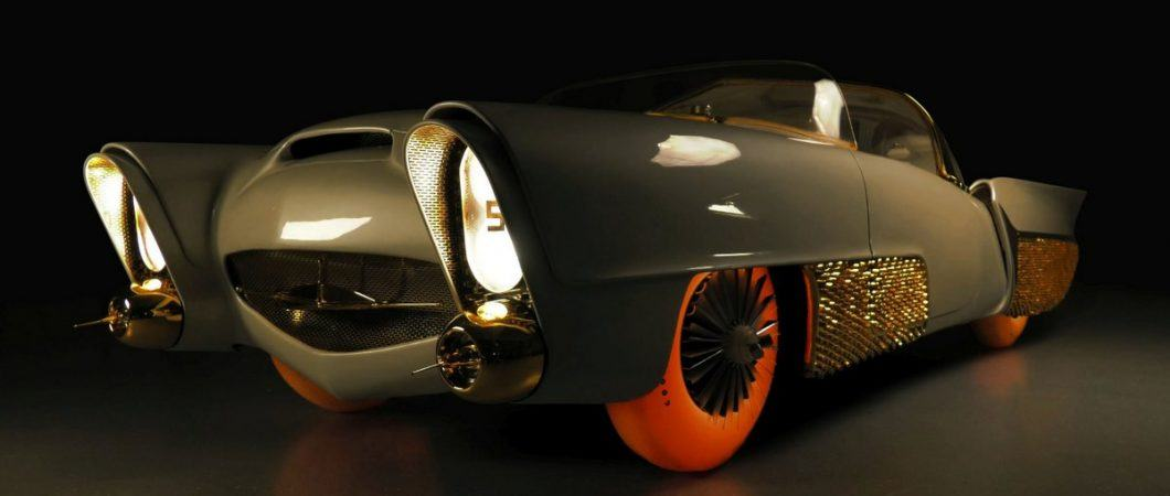 Futuristic grey-green coupe from the 1950s with bright orange tyres