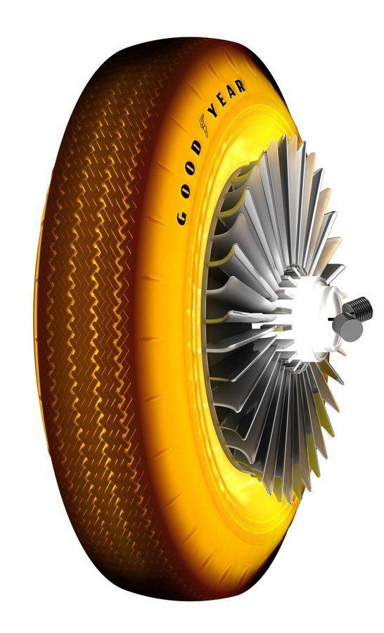 Bright yellow car tyre with turbine blade styled spokes