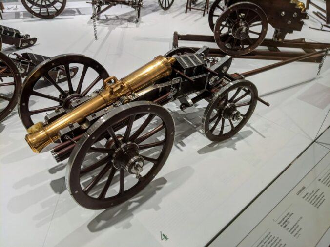 A bronze canon with carriage wheels