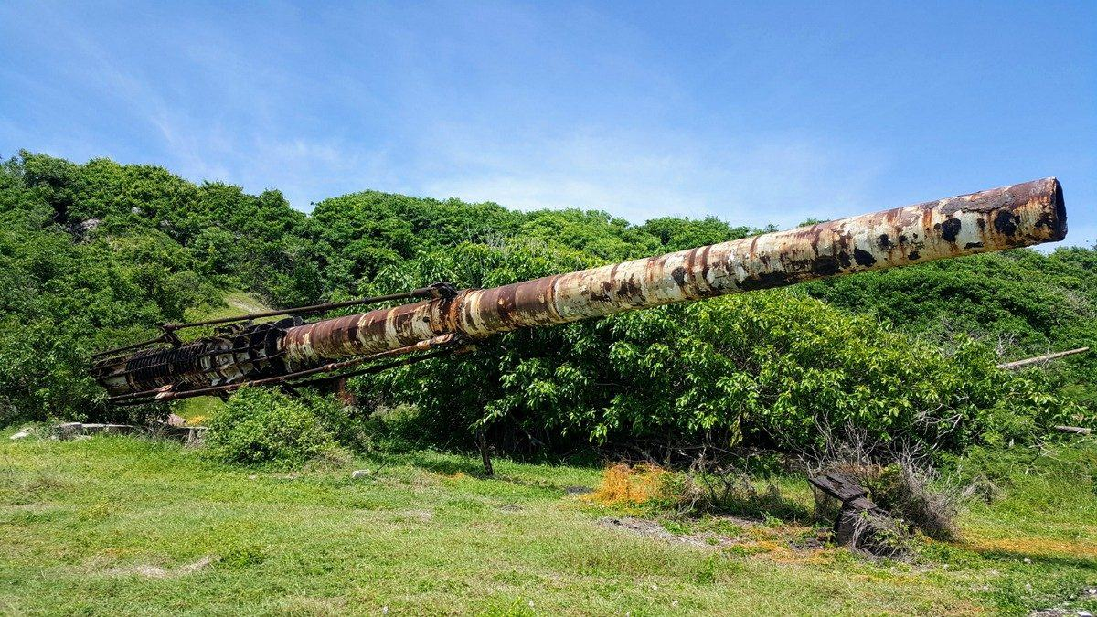 The white painted but rusting 120ft long HARP gun on Barbados ru