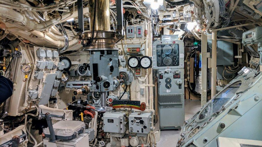 Submarine control room with a periscope in the middle