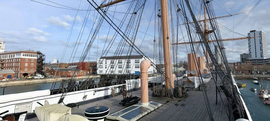 View along the upper deck with Portsmouth buildings in the background and a blue sky