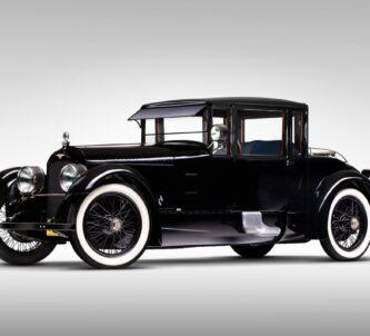 Classic black car with white-walled tyres