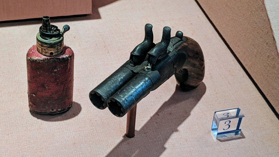 A small double-barrelled pistol