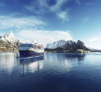 Graphic of a cruise ferry off a snowy coast