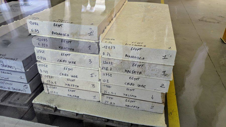 A pile of inscribed headstones are ready for shipping to Egypt