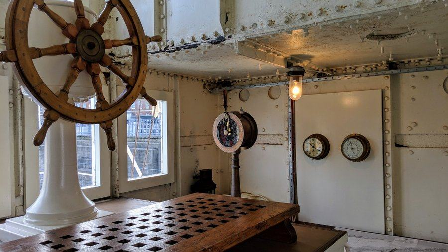 Ship's wheel mounted on a grated plinth