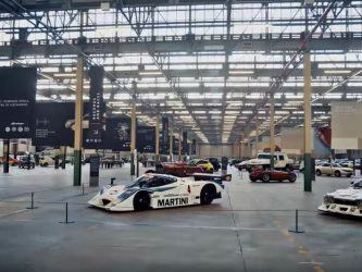Classic cars laid out in a huge industrial space