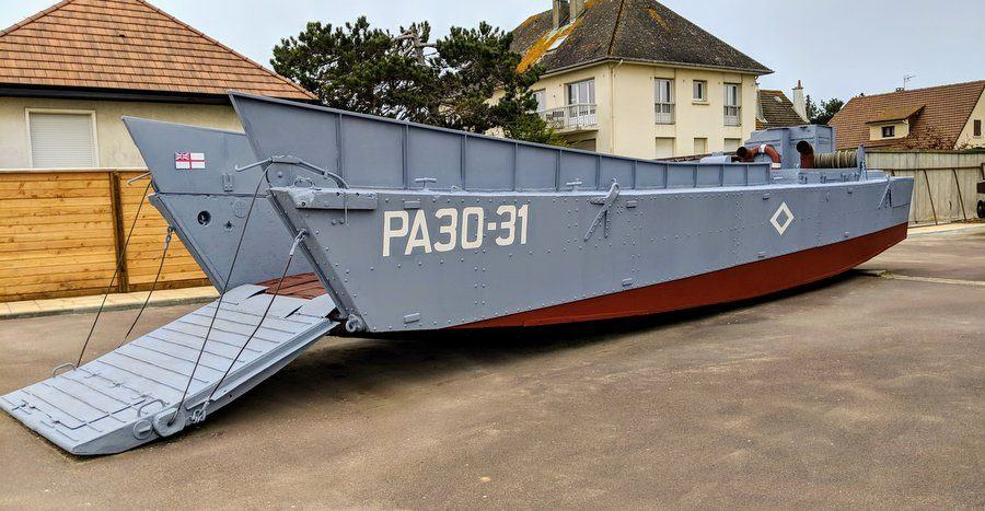 Grey painted landing craft with the ramp down