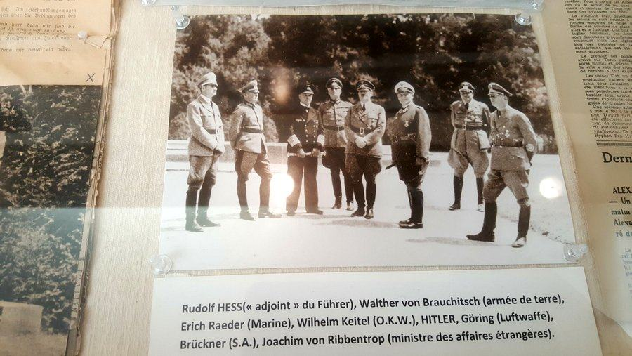 Photo in cabinet of Hitler & group at Armistice site