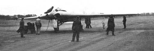 B&W photo of a flying wing being prepared on the tarmac