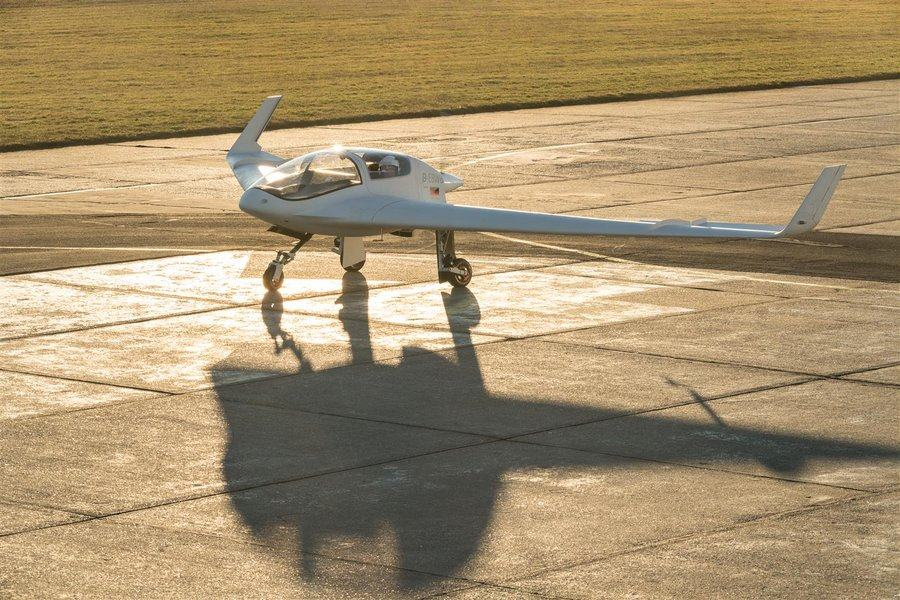White painted flying wing taxiing on tricycle undercarriage
