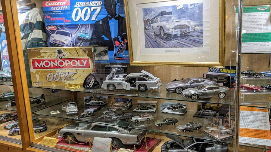 A glass cabinet with James Bond/Aston martin related merchandise