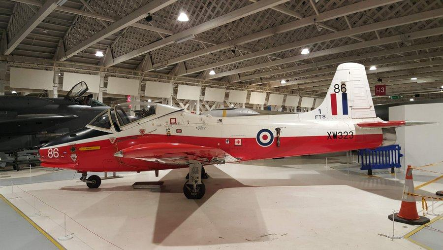 Red underside, white topped, trainer jet. Not very sleek