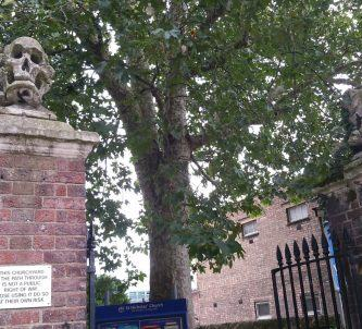 skull & crossed bones carvings on St. Nicholas church gate posts, Deptford