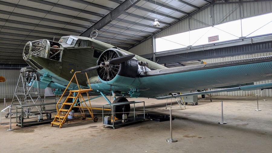 Maintenance ladders and a missing engine from the nose of the normally three-engined Junkers 52, Green i& yellow Luftwaffe colours