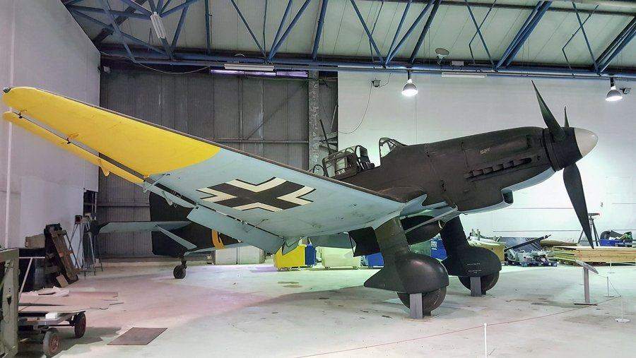 Famous dihedral-winged German dive bomber. Green & brown camouflage on topsides, sky blue undersides and yellow wing tips.
