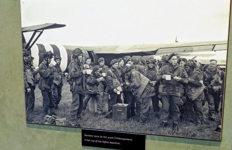 Black and white photo of the airborne troops by their glider