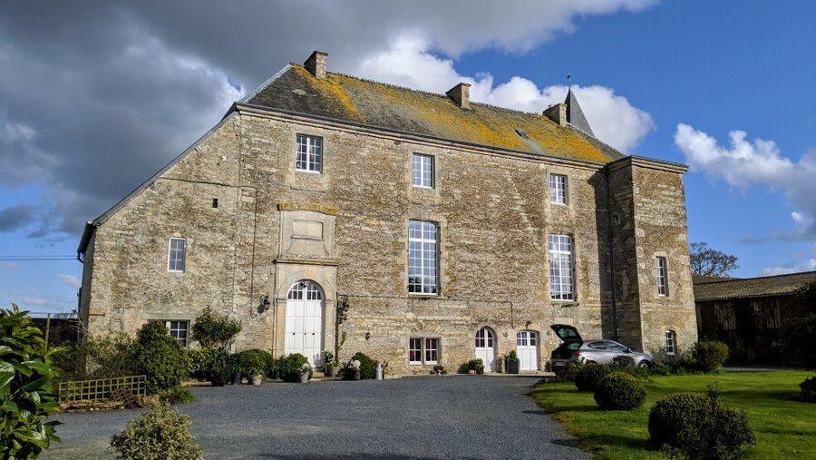 An imposing grey stone manor house