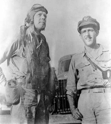 Charles Lindbergh in pilot clothing standing next to Maj. Thomas B. McGuire Jr
