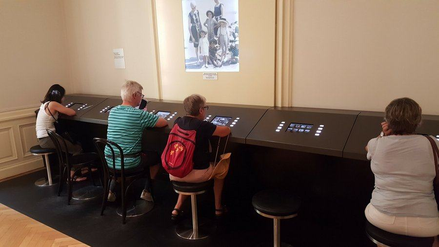 Visitors watching film clips at Musée Lumière