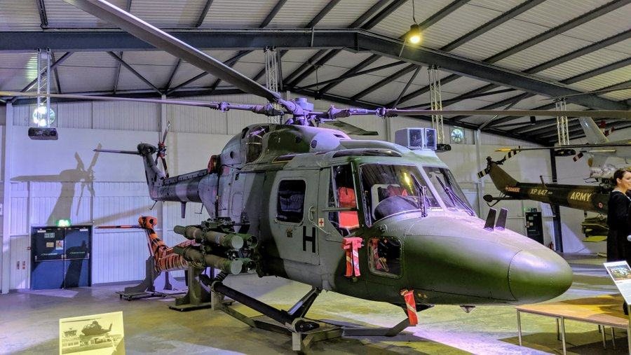 Modern grey & green helicopter with rocket pods