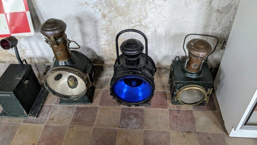 Large old train lanterns with coloured glass
