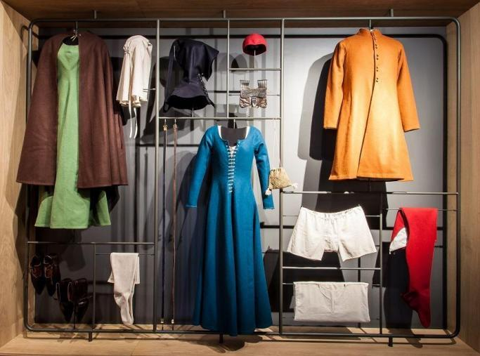 A display of colourful medieval clothing