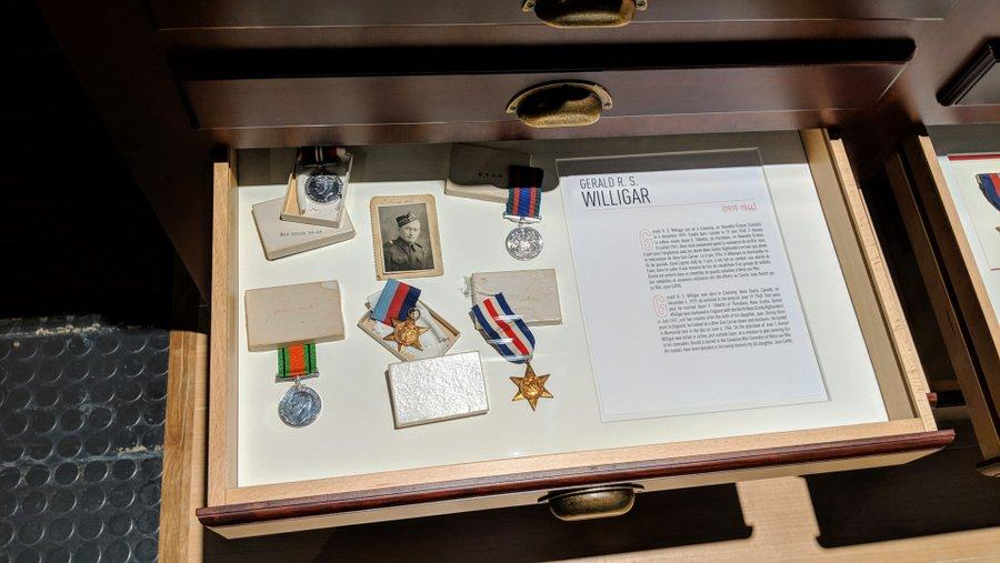 A drawer with photo, biography and medals of a fallen Canadian soldier
