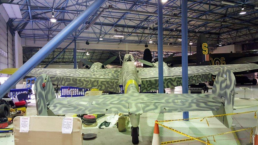 View from behind of the Messerschmitt Bf 110 with its light grey and dark green swirly camouflage