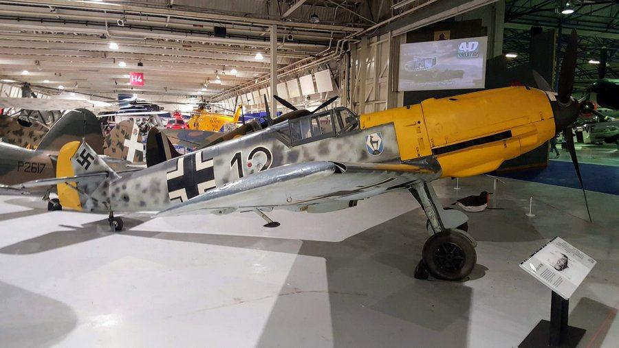 Yellow nosed fighter with mottled grey camouflage and German cross. Very slender and elegant.