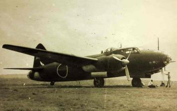 B/W photo of a Mitsubishi G4M bomber on an airfield
