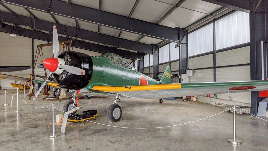 Green painted Japanese WWII fighter with Rising Sun markings, on display in the Salis Flying Museum