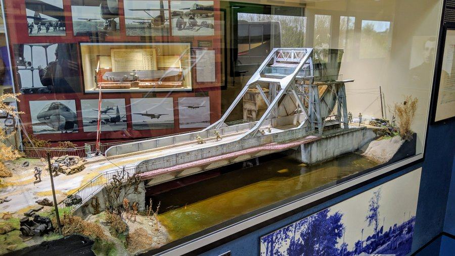 a model of Pegasus bridge in a glass display case