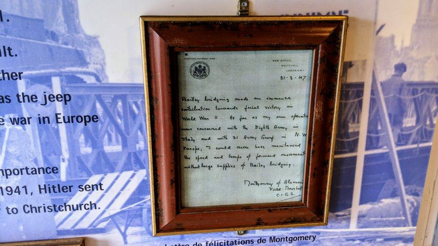 Handwritten letter displayed in a picture frame